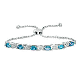 "Oval Swiss Blue Topaz and Diamond Accent ""XO"" Bolo Bracelet in Sterling Silver - 9.5"""
