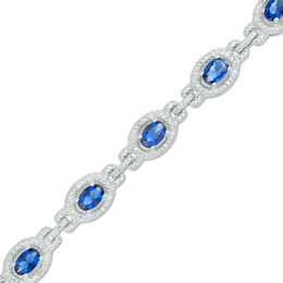 Oval Lab-Created Blue Sapphire and 1/20 CT. T.W. Diamond Frame Link Bracelet in Sterling Silver - 7.5""