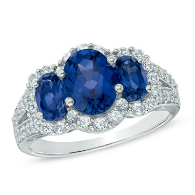 c6fbd49cf8b8a Previously Owned - Oval Lab-Created Blue and White Sapphire Three Stone  Ring in Sterling Silver